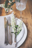 Festive rustic table setting. Vintage style table decor with bird cherry blossoms and old cutlery, festive rustic table setting Royalty Free Stock Photos