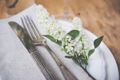 Festive rustic table setting. Vintage style table decor with bird cherry blossoms and old cutlery, festive rustic table setting Royalty Free Stock Image