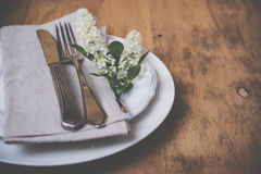 Festive rustic table setting. Vintage style table decor with bird cherry blossoms and old cutlery, festive rustic table setting Royalty Free Stock Images