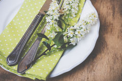 Festive rustic table setting. Vintage style table decor with bird cherry blossoms and old cutlery, festive rustic table setting Stock Image