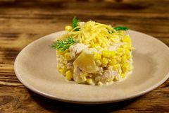 Festive salad with chicken breast, sweet corn, canned pineapple, cheese and mayonnaise on wooden table stock images