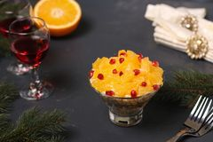 Festive salad with chicken and orange, decorated with pomegranate seeds royalty free stock photo