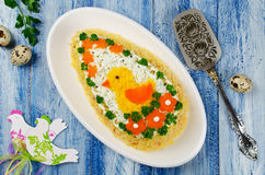 Festive salad Egg decorated with a chick and vegetables Stock Photos