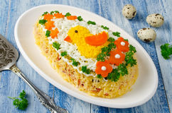 Festive salad Egg decorated with a chick and vegetables Royalty Free Stock Image