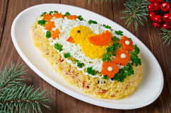 Festive salad Egg decorated with a chick and vegetables Stock Images