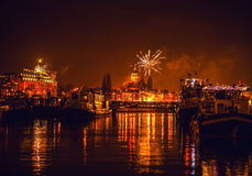Festive salute of fireworks on New Year's night. On January 1, 2016 in Amsterdam - Netherland. Royalty Free Stock Image
