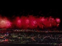 Salute over the city the megalopolis. Festive salute in the night sky. Explosions of fireworks royalty free stock photo