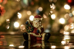 Festive santa. With Christmas light background stock photography