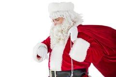 Festive santa claus checking time Stock Photo