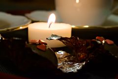 Burning candle. Red Hearts. Wonderful reflections. Valentine`s Day stock photos