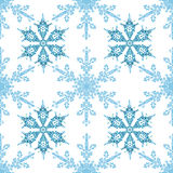 Festive seamless pattern with blue colored snowflakes on white background Royalty Free Stock Photo