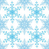 Festive seamless pattern with blue colored snowflakes on white background Royalty Free Stock Photos