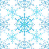 Festive seamless pattern with blue colored snowflakes on white background Royalty Free Stock Photography