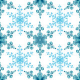 Festive seamless pattern with blue colored snowflakes on white background Stock Photos