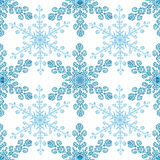 Festive seamless pattern with blue colored snowflakes on white background Royalty Free Stock Images