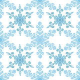 Festive seamless pattern with blue colored snowflakes on white background. Vector illustration Stock Photo