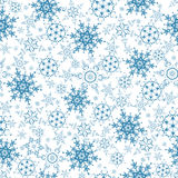 Festive seamless pattern with blue snowflakes Royalty Free Stock Photo