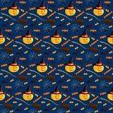 Festive seamless pattern. Halloween characters jack o lantern, witch hat, broom, bat, spider, web, sweets. Vector illustration on. A dark background. Usable for Royalty Free Stock Photos
