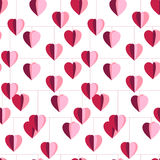 Festive seamless pattern with hanging hearts cut from paper. Endless texture for your design, greeting cards, announcements, posters Royalty Free Stock Photos