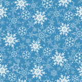 Festive seamless pattern with ornate snowflakes Stock Images