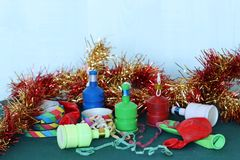 The festive season. A collection of festive party decorations, including tinsel streamers and party poppers Royalty Free Stock Photography