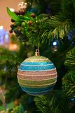 Festive Season Decorations with Multi Color Ball Shaped Glitter Ornament on the Christmas Tree royalty free stock image