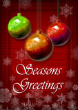 Festive Season Greeting Card. A Festive Season Greeting card in red with snowflakes and hanging colored decorations Stock Image