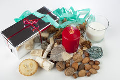Festive seasonal christmas diplay with mince pie and candle Royalty Free Stock Photography