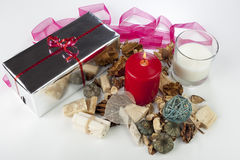 Festive seasonal christmas display with a silver wrapped present Stock Images
