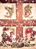 Festive Seasonal Window. Looking into a festive seasonal Christmas window as snow falls outside Stock Photography