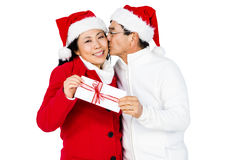 Festive senior couple exchanging gifts. On white background Royalty Free Stock Photos