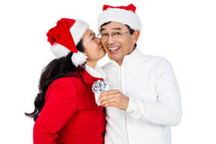 Festive senior couple exchanging gifts. On white background Stock Photography