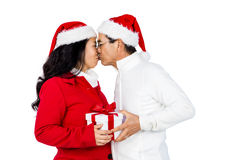 Festive senior couple exchanging gifts. On white background Stock Image