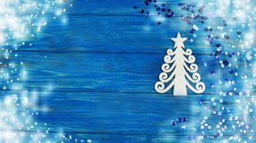 Festive shiny decoration toy white christmas tree. On a wooden blue background with snow on new year and christmas Stock Image