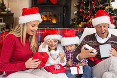 Festive shocked family exchanging gifts Royalty Free Stock Images