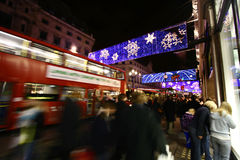 Festive shopping. Crowds doing their festive shopping at a very busy Oxford Circus, central London, showing movement blur Stock Image