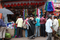 Festive Shopping. People in India shopping various ritual and decoration items during a festival at a streetside shop Royalty Free Stock Photo