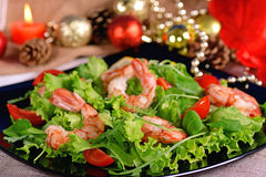 Festive shrimp salad, arugula and tomatoes Stock Photos