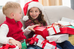 Festive siblings surrounded by gifts Stock Image