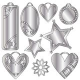 Festive silver tags, hearts and stars. Over white background Stock Image