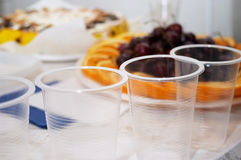 Festive smorgasbord. Corporative birthday (focus on the plastic-glass Royalty Free Stock Image