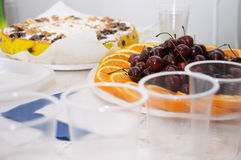 Festive smorgasbord. Corporative birthday (focus on the fruits Royalty Free Stock Photography