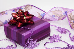 Festive snowflakes with gift box Stock Photos