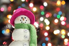 Festive snowman. With Christmas light background Stock Photos