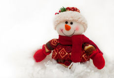 Festive snowman. Plush holiday snowman standing in the white snow Stock Photography