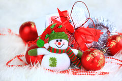 Festive snowman with. Christmas light background Stock Images