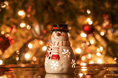 Festive snowman. With Christmas light background royalty free stock image