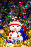 Festive snowman with Christmas balls, tinsel on blurred lights background Royalty Free Stock Photography