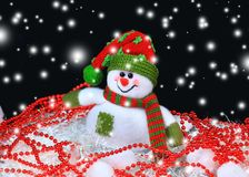 Festive snowman with Christmas light Stock Images