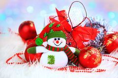 Festive snowman with Christmas. Light background Royalty Free Stock Photo
